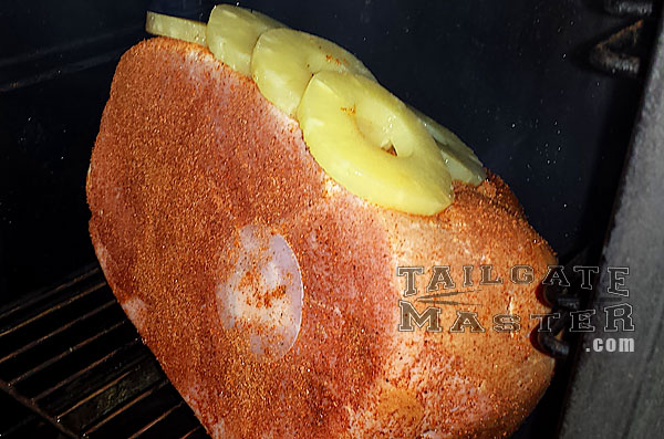 tailgating pineapple topped peachwood smoked ham in the smoker