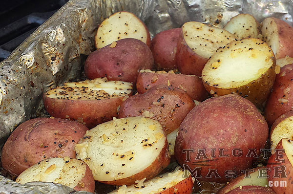grilling baby red potatoes on the grill in butter
