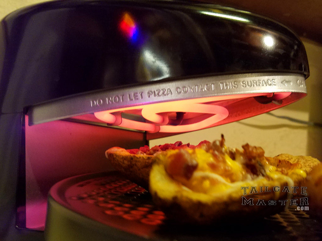 photo of pizzazz pizza oven making cheesy bacon potato skins