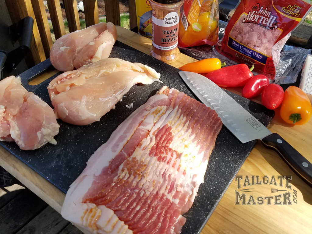 bacon, chicken, cutting board, peppers and ham