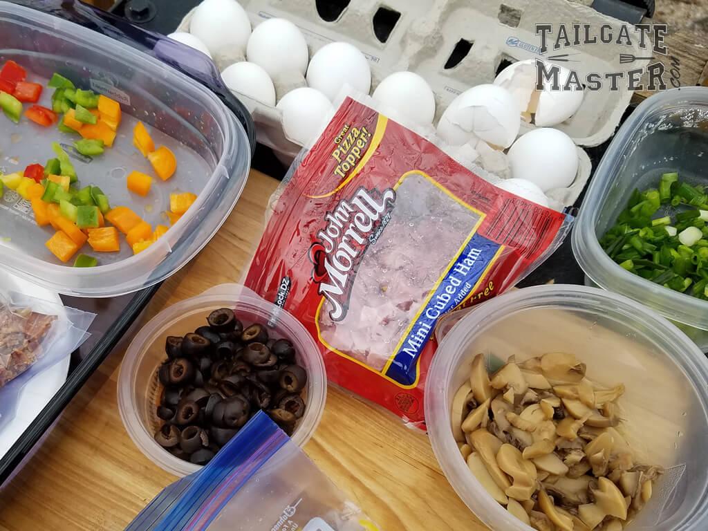 breakfast omelette ingredients peppers, ham, bacon, cheese, mushrooms, black olives, egs
