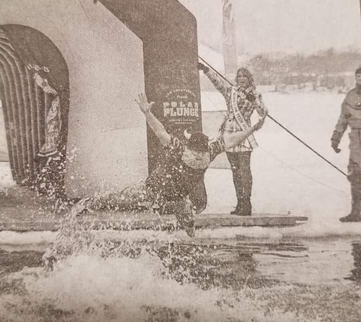 Admiral BigGun jumps into a frozen lake at a polar plunge