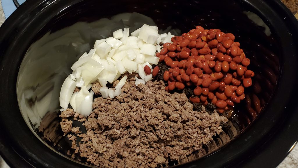 Browned hamburger, chopped onions and beans
