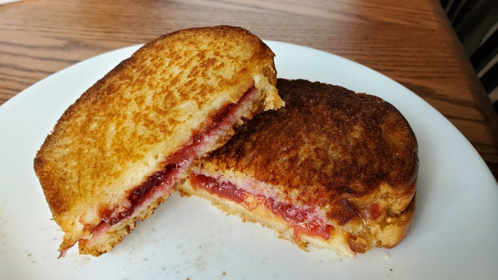 Gloriously simple peanut butter and jelly sandwich on the blackstone