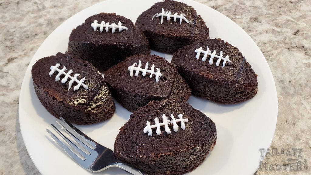 chocolate fudge football shaped brownies with frosting laces